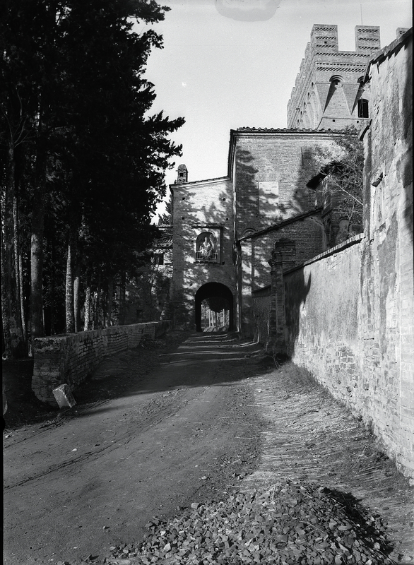 [Abbey of Monteoliveto Maggiore (Italy), entrance with square tower seen from inside]