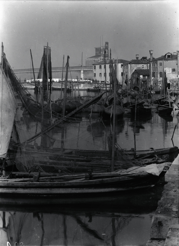 [Venice (Italy), fishing-boats and gondolas, with Arsenale in background]