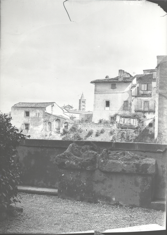 [Viterbo (Italy), sarcophagus with houses in the background]
