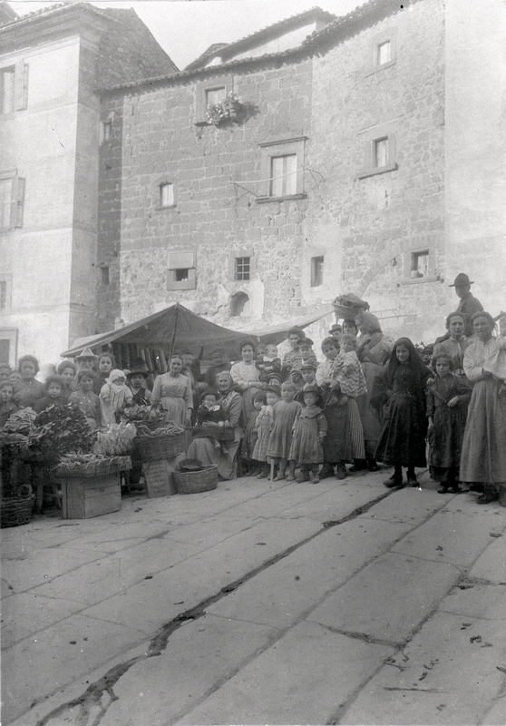 [Soriano nel Cimino (Italy), market in square with group of people]